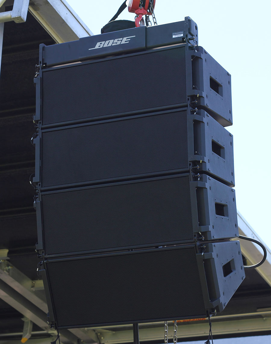 Bose speakers mounted near stage in Tracy