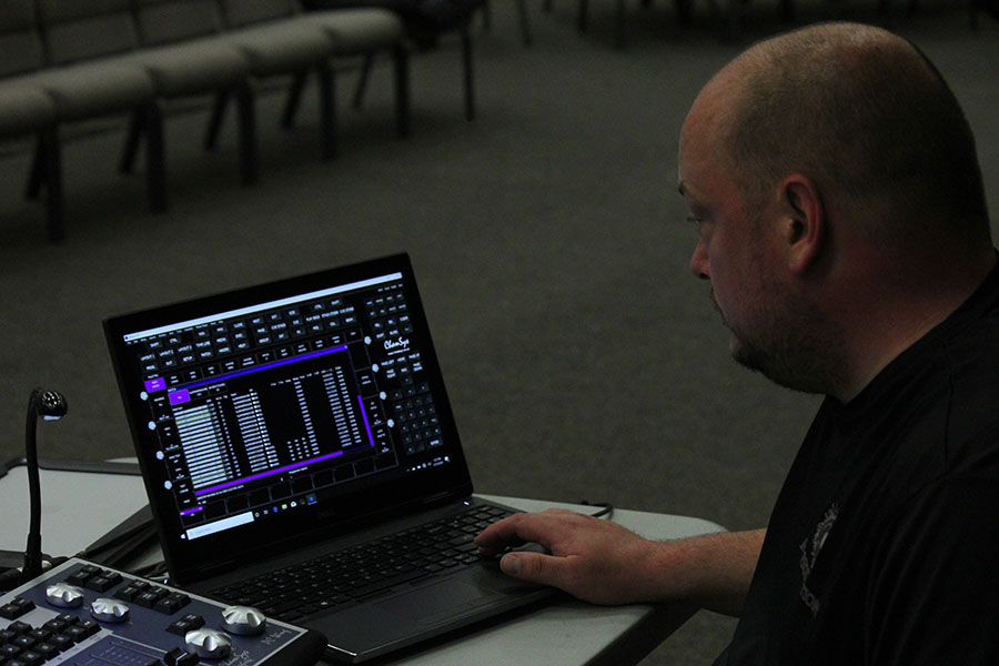 Mike working with software for lighting installation